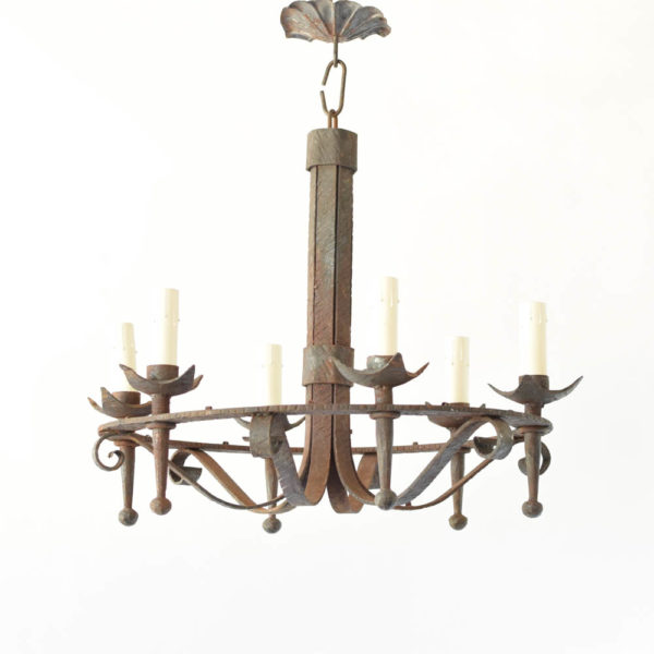 Very heavy forged iron basket form chandelier with rusty finish