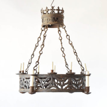 Antique French iron chandelier in the Neogothic style with pierced band and large crown at top