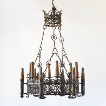 Antique French chandelier with hand forged scrolls in the art nouveau form