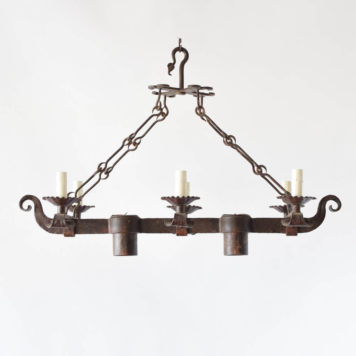 Elongated chandelier with down lights