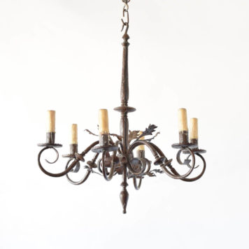 Antique hand made iron chandelier with simple forged arms and leaves