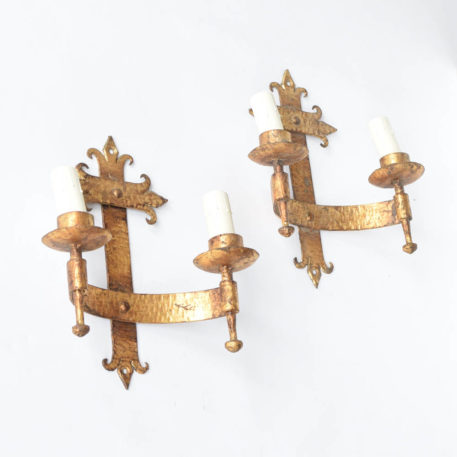 Gilded Iron sconces from Spain with hammered metal and fleur de lis design