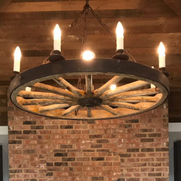 Antique Carriage or Wagon Wheel converted into rustic chandelier