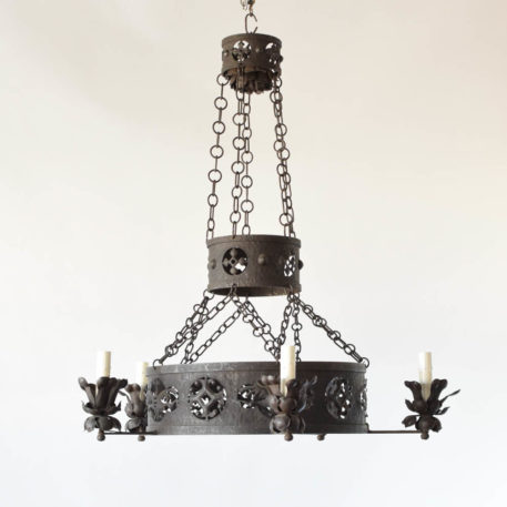 Antique American Arts and Crafts chandelier with piereced iron band depicting alternating geometric patterns and a stylized bird motif