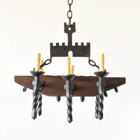 Vintage Wood Chandelier from Belgium with rustic beam body and iron arms and a medieval castle as hanging decoration