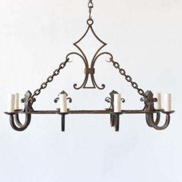 8 light oval chandelier with decorative collector and Florida lee design from France.