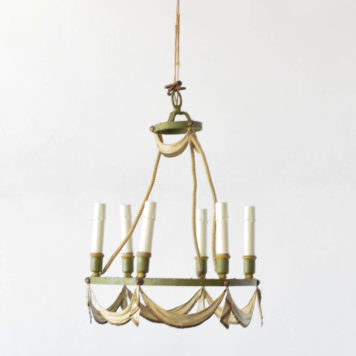 6 light iron toile chandelier from France. The chandelier is painted along with a swag design.