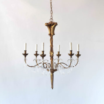 Carved wood chandelier with crystals and distressed painted finish. Genoa style