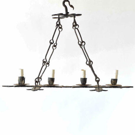 4 Light Iron Chandelier with Fleur de Lis details.