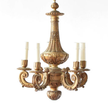 5 light gilded Italian chandelier madeof wood with one central column.