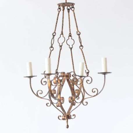 Gold Spanish chandelier in basket form suspended by twisted rods.