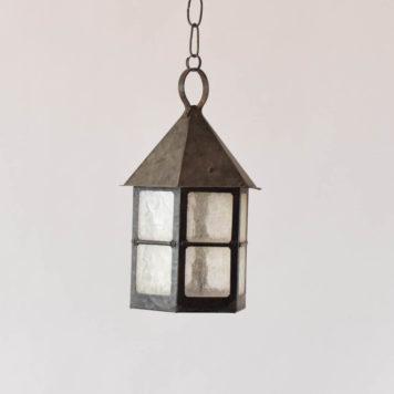 Rustic iron lantern with window style glass panels