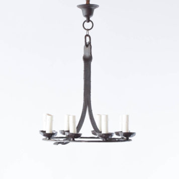 Rustic Belgian chandelier with 8 lights and textured metal.