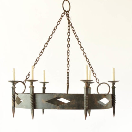 Pair of rustic iron 6 light chandeliers in ring form