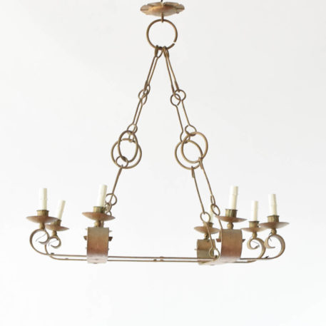 Spanish 8 light square chandelier hung from rods and rings.