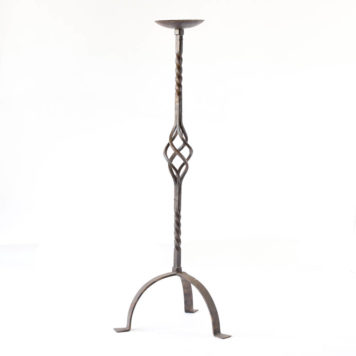 Iron floor lamp with open basket in middle of column