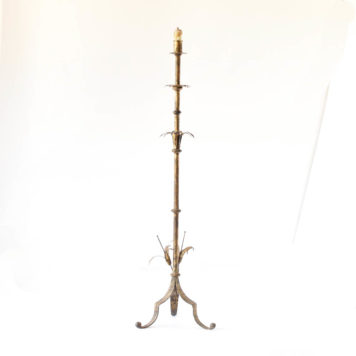 Gilded iron floor lamp in organic form