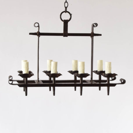 Elongated 8 light french iron chandelier
