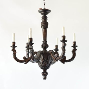 Finely carved antique wood chandelier with leaves and shells carved into main bowl of fixture