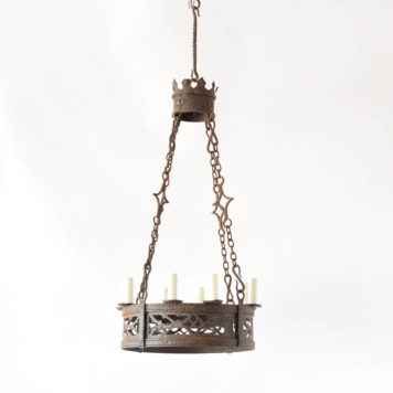 Early 1900s French chandelier with hand forged iron rings holding a pierced band of iron