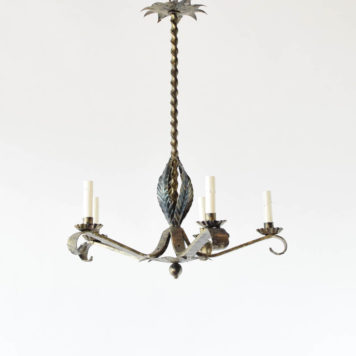 Vintage Spanish chandelier with tall twisted column and pointed forge arms with leaves underneath
