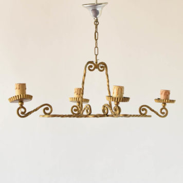 Simple iron chandelier having an elongated form made from twisted square bar stock