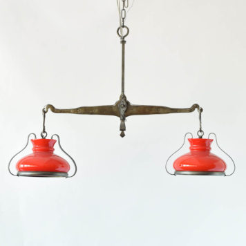 Chandelier made from an antiqure balance with red shades