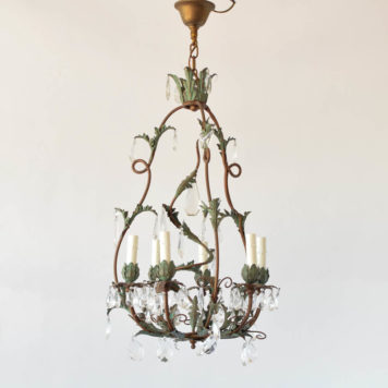 Vintage French chandelier made from iron with leaves and crystal decorations