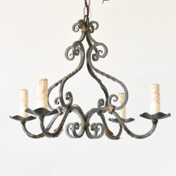 French Country chandelier with green patina and twisted metal arms