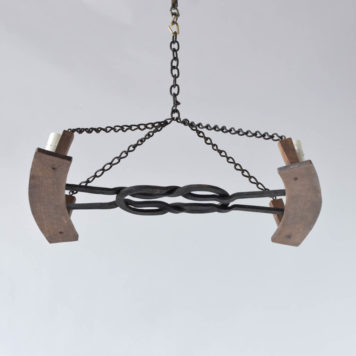 Vintage Iron Chandelier with Hand forge knot in center holdig 2 wood fragments