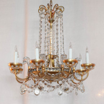 Large italian chandelier with hanging crystal and central lighting