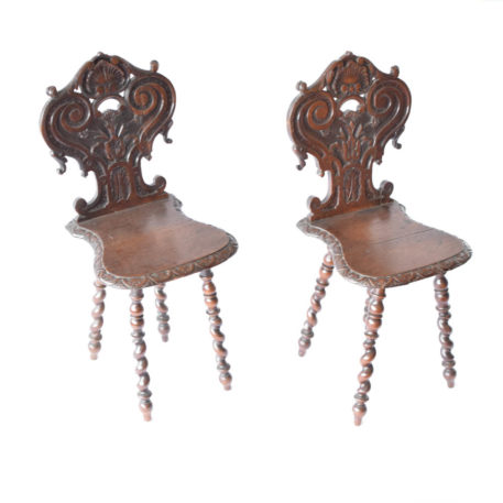 Pair of carved wooden hall chairs