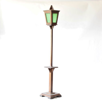tall wooden lantern with small table