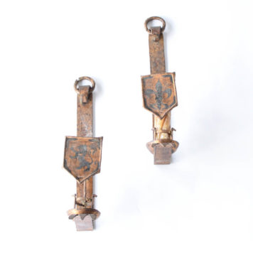 Pair of gold iron sconces with shields