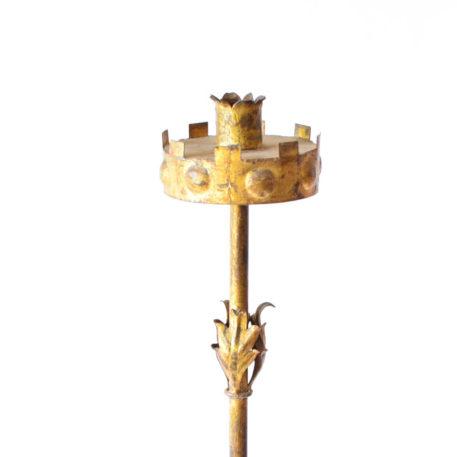Crown detail on top of gold floor lamp
