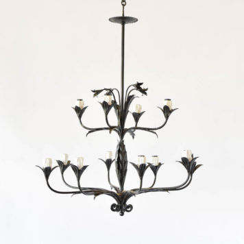 Tall thin leafy chandelier with flower form bobesches and flowers at top