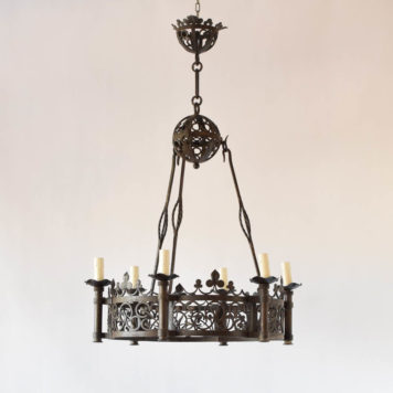 Large vintage French chandelier with clover motif throughout fixture hanging from rods and a sphere