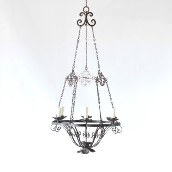 Iron bowl form chandelier from Spain with iron scrollwork on the chains that hold the chandelier