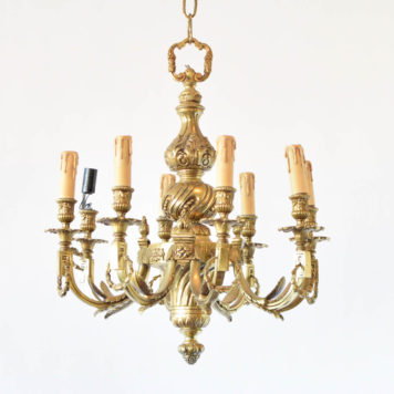 Heavy casted bronze chandelier from France with nicely casted bronze column, arms, and wreath details