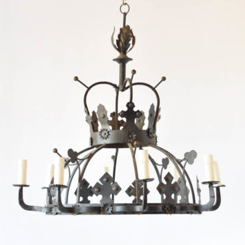 Large iron chandelier from France with an overall crown shapedecorated with crosses, stars, clovers, and iron balls
