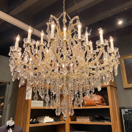 Very large Italian MAria Theresa chandelier with bright gold finish on the metal and hand cut prisms on the arms
