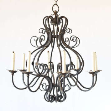Large French iron chandelier with fleur de lis and rosette decorations on alternating arms