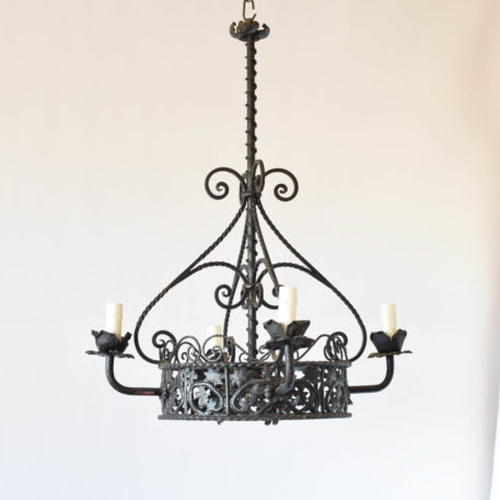 Antique iron chandelier from Spain with iron band with perforated design and 4 arms with flowers under the candles