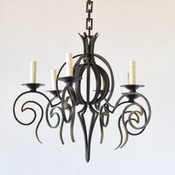 Unusual Belgian vintage iron chandelier orb in the middle surrounded by 6 curved arms