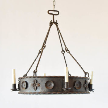 Vintage French chandelier made of a simple iron band adorned with 2 types of stamped metal flowers. The fixture is suspended from four sets of rods with twisted iron in the center and loops on the ends