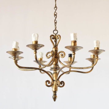 Gilded Spanish iron chandelier with 6 simple arms and lights on 2 levels. This light is from Northern Spain and was made in the mid 1900s