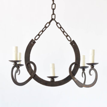 Rustic French chandelier with U form in the middle of 4 hand forged arms