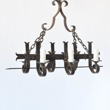 French chandelier made of long forged iron fleur de lis