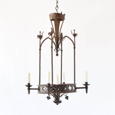 Antique Iron chandelier from France with a neo gothic design including curved arches, twisted iron arms and hammered flowers