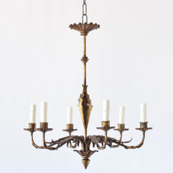 Vintage Spanish chandelier with thin column and leaves under the simple arms